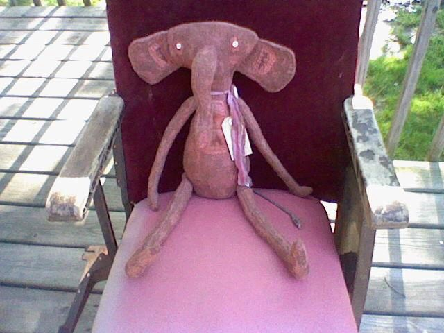 Elephant sitting in an old movie theater seat. Willow Creek Primitives, Tomah WI. Also on Facebook!