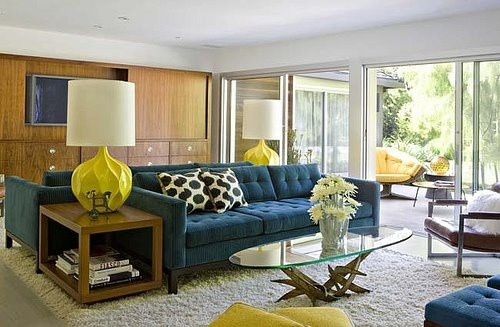 Extra large yellow table lamps in mid century living space of navy, brown and cream