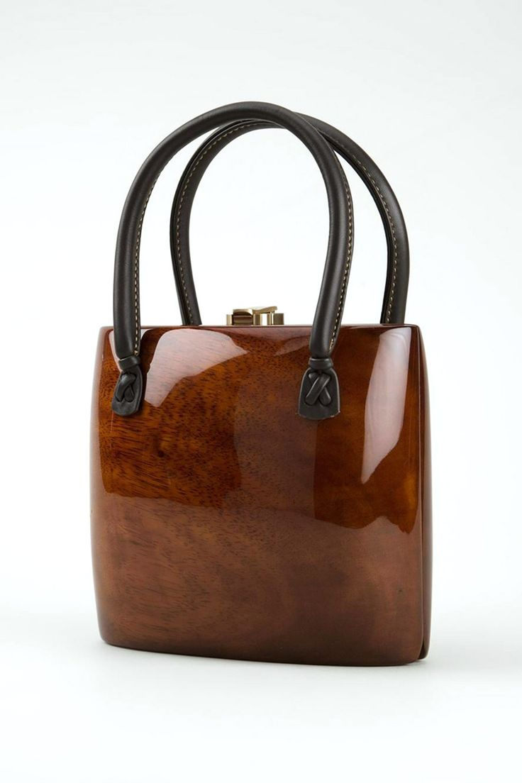 """Natural Helena handbag from Rocio featuring a top gold-tone foldover closure and leather handles. 7"""" H x 8"""" W x 4"""" D 100% acacia wood"""