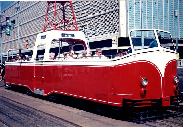 """Blackpool Balloons - A worthy companion of the Balloons is the Boats class, also built by English Electric in 1934. These cars are single deck open-topped models with central doors and gangway. They are numbered 600-607, originally 225-236 and have a passenger capacity of between 52 and 56. They are known as """"the boats"""" due to their ship-like streamlined appearance and are one of the most iconic Blackpool trams. All cars are virtually identical, except for 600, which has shorter body panels."""