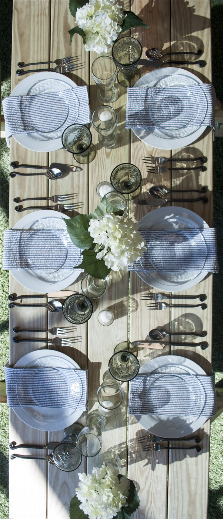 Al-fresco outdoor dining on picnic tables for an intimate backyard garden dinner party | Celebrations! Party Rentals and Tents