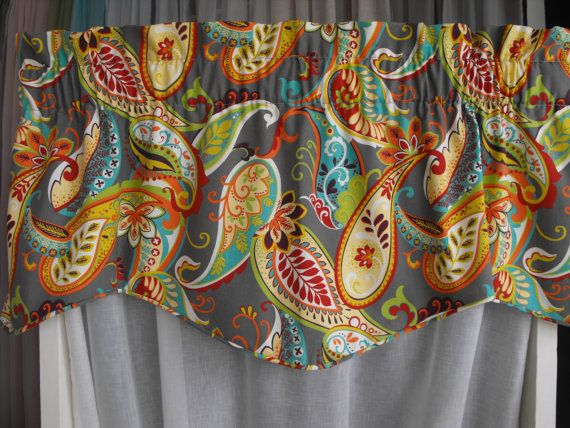 Red , teal , orange, sea green, yellow on an Grayish mocha background 50 inches wide x 18 inches long 3 inch rod pocket lined and corded  Shown here on a 30 inch wide window  **Window widths ** 25 to 36 inches wide use 1 valance 36 to 72 inches wide use 2 valances 72 to 100 wide use 3 valances 100 to 144  wide use 4 valances Bay window use 4 valances - 1 ea for sides - 2 in the center door use 1 valance French doors use 2 valances Sliding glass door up to 78  wide use 2 valances  Wash in…