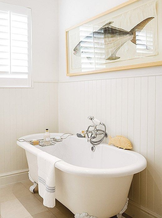 Love every sweet coastal-inspired detail of this all-white master bathroom.