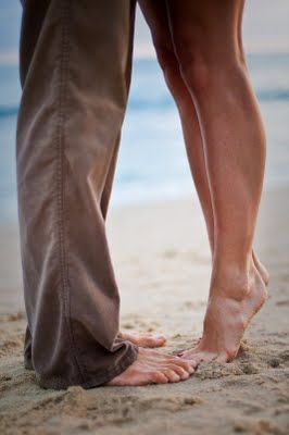 engagement photo idea - this is pretty cool.  But I'd write the date in the sand.
