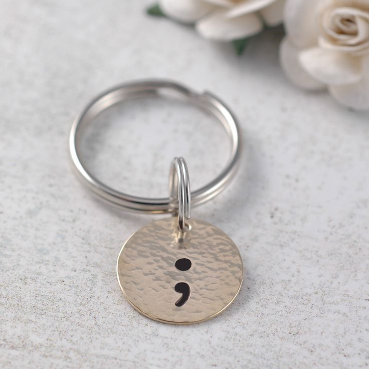 Semicolon Key Chain, Project semicolon, Your story isn't over,  You are a Warrior, hand stamped gold hammered disc by DivineJewelrybyMary on Etsy https://www.etsy.com/listing/493643923/semicolon-key-chain-project-semicolon