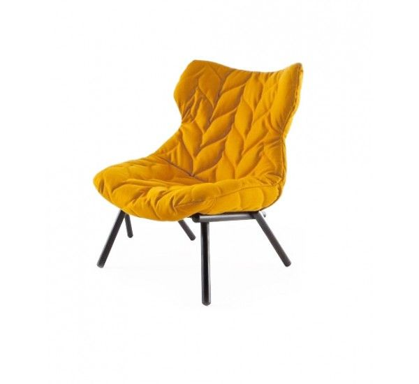 Foliage Armchair is a dialogue between natural and artificial reality created specifically for residential use with a clear graphic of Patricia Urquiola.The leaves form a crown that rests on the structure composed of branches forming a virtual session. Great personality characterized by a soft seat with embroidery stitching that runs along the entire surface, even on the back, for a maximum effect of aesthetic exaltation, visible all round from every corner of the living area.