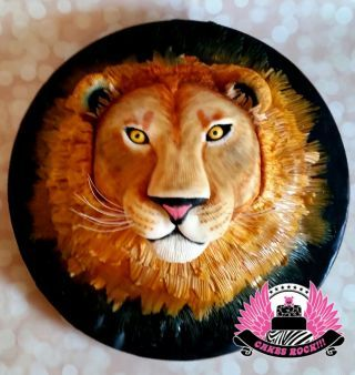 3D lion head, 100% cake. Fondant and modeling chocolate decor, with airbrushing and hand-painting. Hot Chocolate cake with white chocolate buttercream filling.