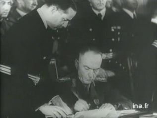 In Berlin... Marshal Antonescu, the leader of Romania, agrees to join the Axis powers. There are also talks on preparation for a German attack on Greece by the forces based in Romania. German is putting pressure on all the Balkan states since the Italian invasion of Greece in an attempt to ensure the stability of food and oil supplies.