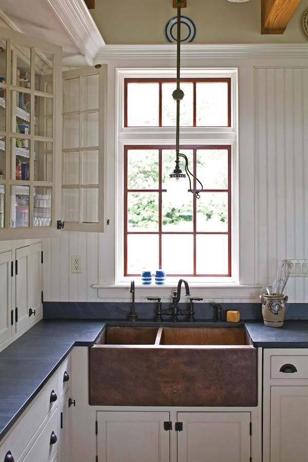 The single-story kitchen, connected by a hyphen, makes perfectly clear where the historic house ends and the new part begins. Muse Architects.
