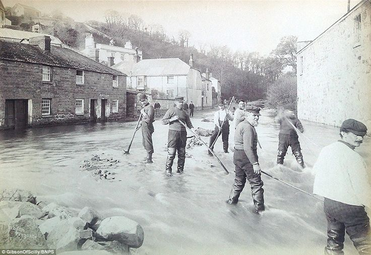 RISING TIDE | Newlyn, Cornwall: 'Men in Newlyn do their best to clear the streets of floodwater and protect homes in the seaside town from the rising tide.' ✫ღ⊰n
