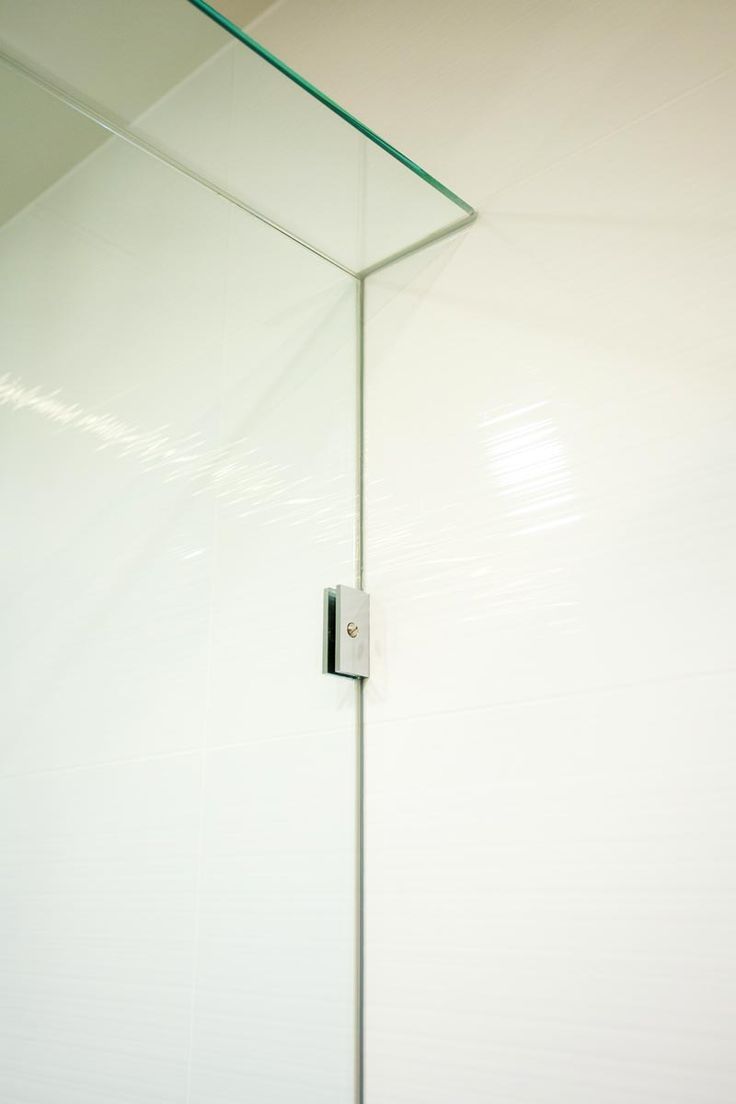Wall bracket hold the glass panel in place