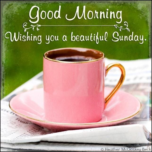 Good Morning. Wishing you a beautiful Sunday Good morning message with a pink cup and newspaper
