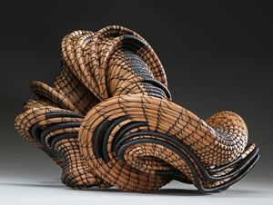 Basketry by Peggy Wiedemann - 'over and out' - pine needles, grasses and waxed linen thread.