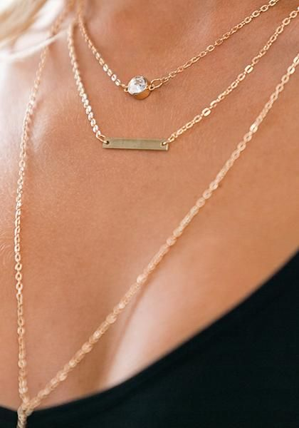 Get that chic feminine look by adding this gold layered Y necklace to the mix.