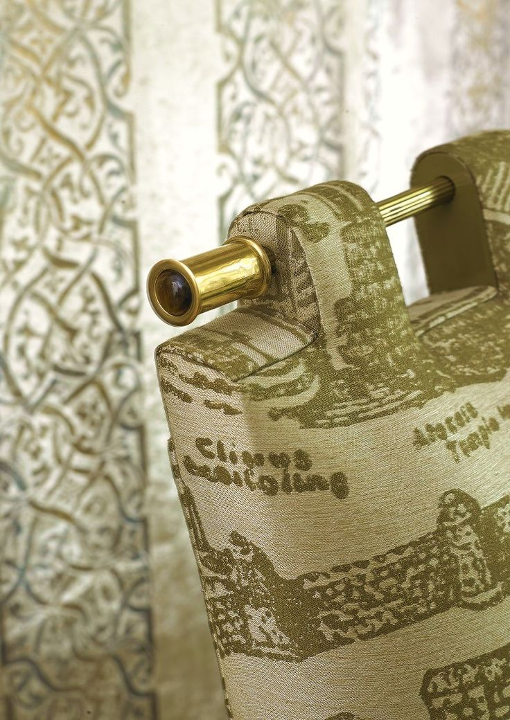 A gemstone detail - tiger eye cabochon featured in the decorative brass baton of the BATON chair by MARI IANIQ. #MARIIANIQ #luxury #bespoke #handmade #gemstone #cabochon #brass #BATON #chair #interiors #design #decor