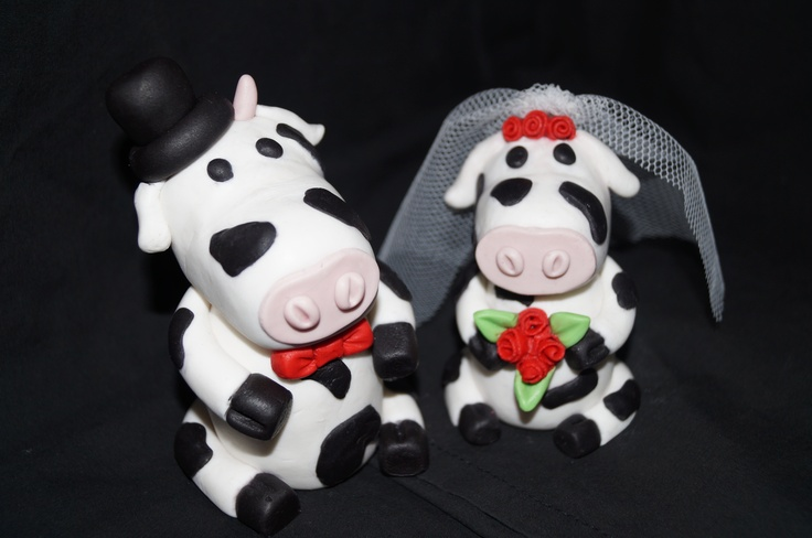 Hand made fondant cow toppers