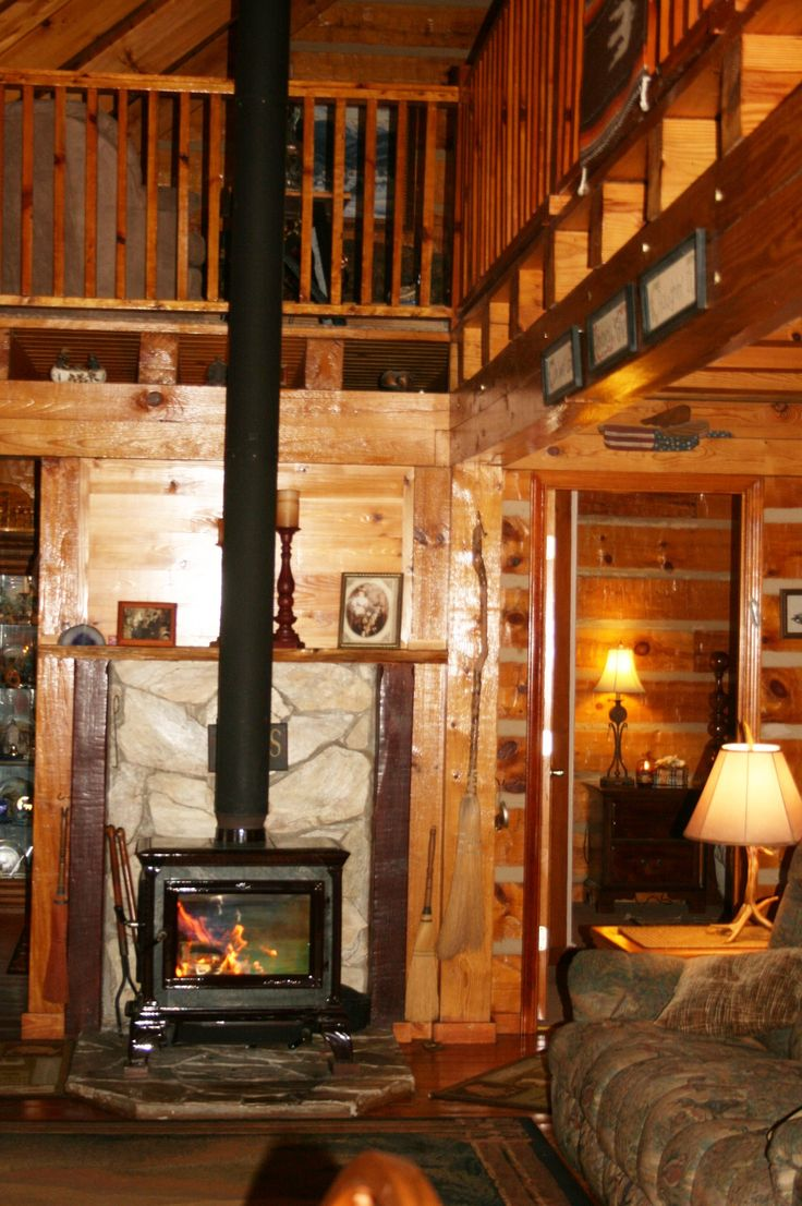 Hearthstone wood stove in log home heats over 2000 sq for Hardwood floors 2000 sq ft