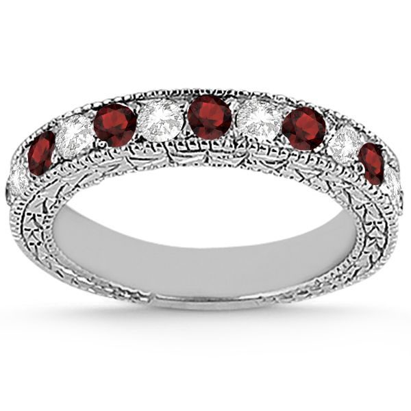 This vintage style semi eternity diamond and garnet wedding ring features 7 brilliant cut VS2 G-H round diamonds alternating with 6 colored gemstones.<P>The 14kt White Gold garnet ring has milgrain edges and a filigree design for the ultimate designer's touch.<P>Wear it as a wedding band, as an anniversary ring, or as a right hand fashion ring.<P>The garnet wedding band measures 4.20mm tapering off to 3.95mm and is set in a pave setting.