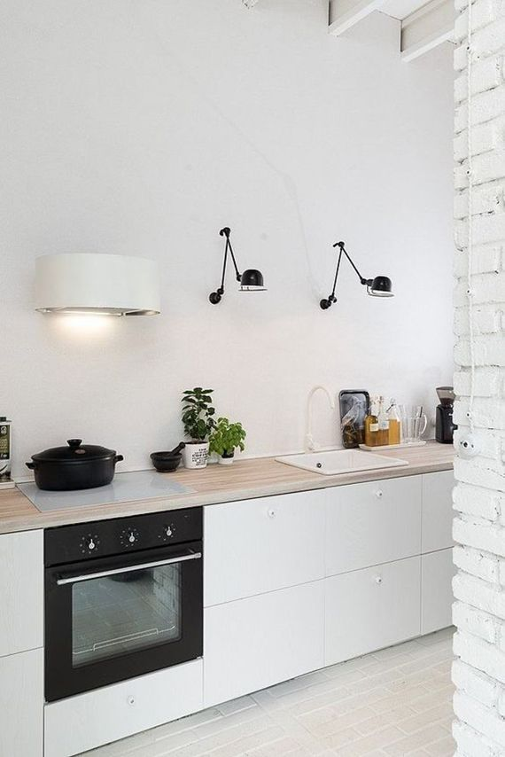 Swing arm lamps in the kitchen