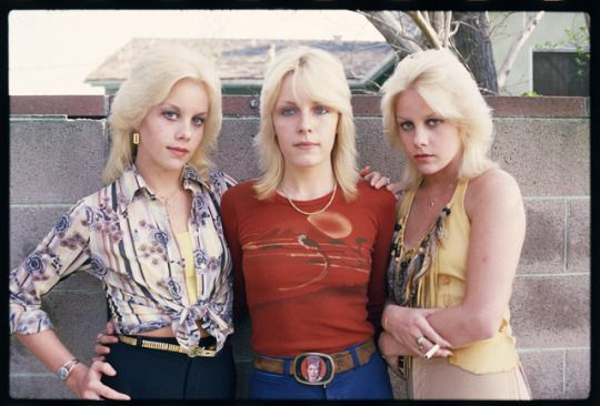Cherie Currie of The Runaways with her twin sister Marie and Vicki Razorblade, 1977