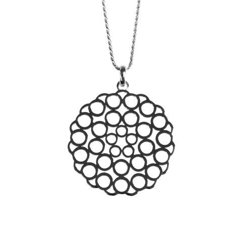 ANTIKA Chartres pendant has a pattern reminiscent of the stained glass windows of the Chartres Cathedral in France. It's feminine and light and easy.