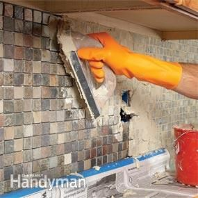 Installing tile backsplash...  Now maybe Rich will be willing to tackle this with me????