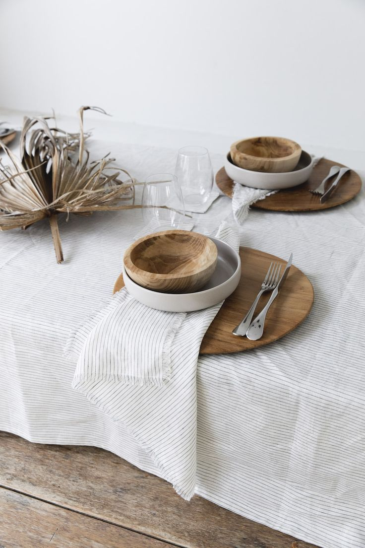 striped table linen with wooden and ceramic dishes. / sfgirlbybay