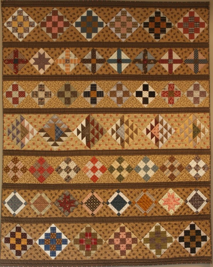 "Civil War Row Quilt - inscribed with a line from Abraham Lincoln's famous speech in 1858 ""a nation divided against itself cannot stand""."