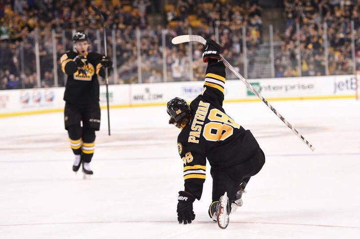 MARCH 8 : David Pastrnak #88 of the Boston Bruins celebrates a goal against the Detroit Red Wings at the TD Garden