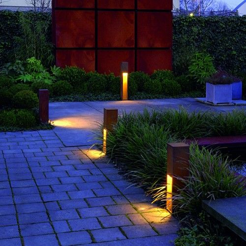 The rusted looked of this path light gives an industrial look to gardens and blends organically with the landscape it's illuminating. http://www.ylighting.com/blog/nightime-curb-appeal-outdoor-lighting/