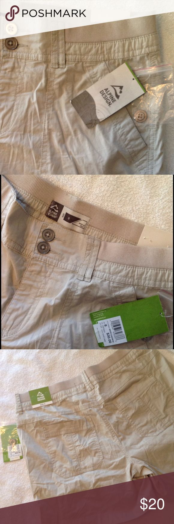 Alpine Design beige shorts - size 8 They call the color silver lining - looks like a light beige to me.  New with tags.  2 larger pockets in front and one smaller inside a pocket.  2 more large pockets in the back. Great hiking shorts! alpine design Shorts
