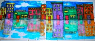 Color top half with Crayola markers. Spray bottom half with water. Fold paper and press. Voila!