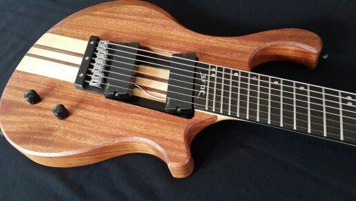 The BTB8x 8 string multiscale ER guitar.  Mahogany maple and walnut with a macassar ebony fret board.