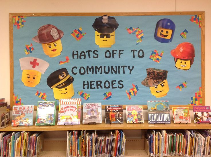 A board of Lego community heroes!  Includes fireman, nurse, pilot, astronaut, army, construction worker, and police man.  Included are a display of books about various community heroes.