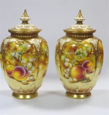 A pair of Royal Worcester vases with hand painted fruit by S. Wood.