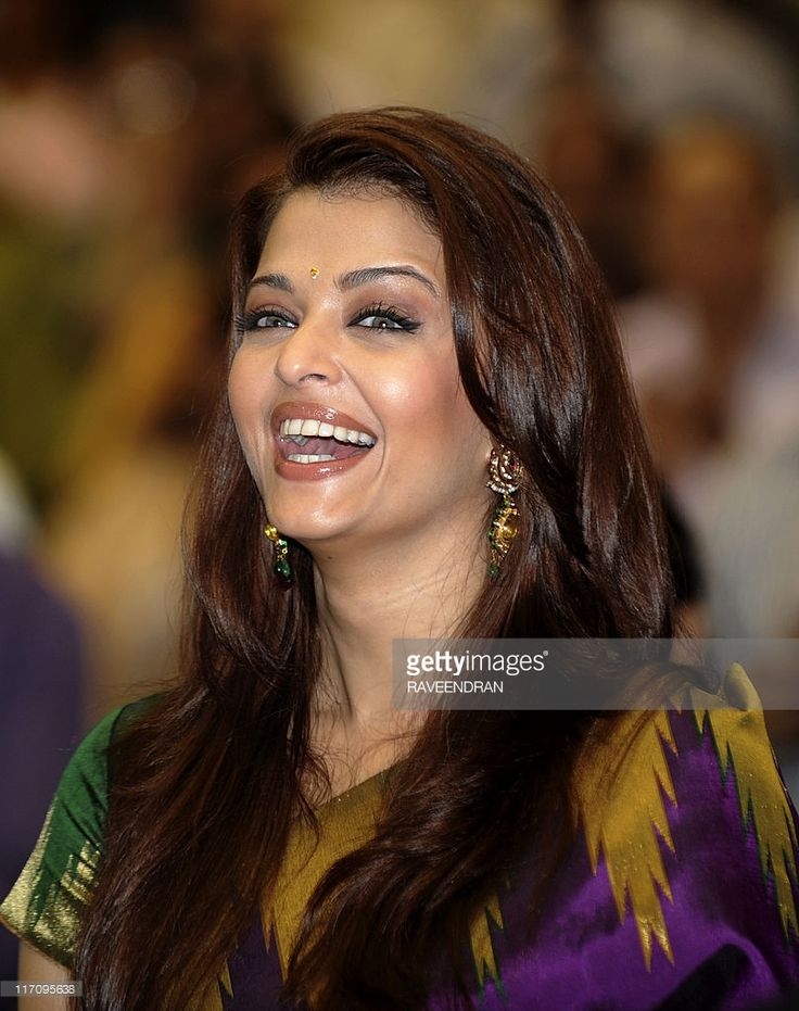 In this file photograph taken on October 22, 2010, Indian actress and former Miss World Aishwarya Rai Bachchan smiles as she attends the 57th National Film Awards Function in New Delhi. Former Miss World turned Bollywood actress Aishwarya Rai Bachchan is pregnant, her father-in-law Amitabh Bachchan has revealed late June 21, 2011 on his Twitter account.