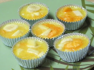 Frozen Fruit Cups- perfect for kids  Ingredients:  2 packages (3 oz each) lemon jello  4 cups boiling water  1 can (20 oz) pineapple tidbits, undrained  1 can (14 oz) mandarin oranges, drained  6 oz. frozen orange juice, partially thawed  2 large firm bananas, sliced  Foil muffin cups