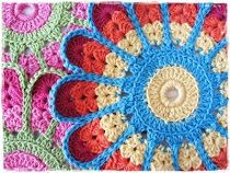 Recipe for crocheted colorful potholder. Translate to Irish, then translate again to English. UK terms used.