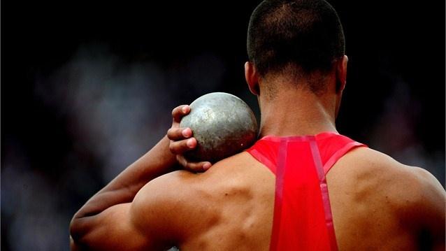 Ashton Eaton of the United States competes in the men's Decathlon shot put