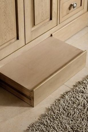 """29. Install a slide-away """"step"""" in your bathroom baseboard to solve your short person problems."""