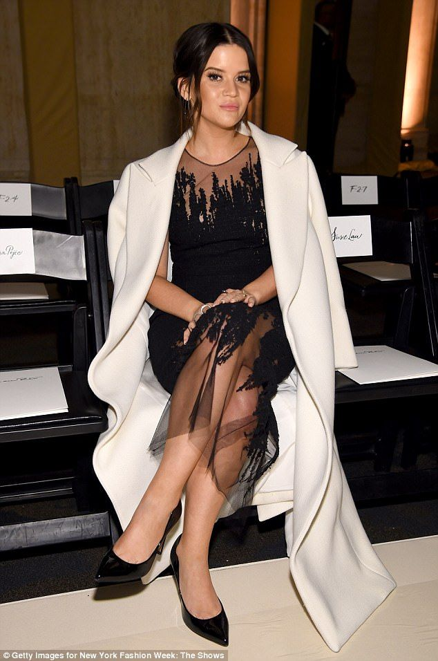 The 23-year-old actress looked supremely stylish wearing a glittering silver frock sitting alongside new mother Nicky Hilton, who donned a navy-and-white striped top and matching skirt.