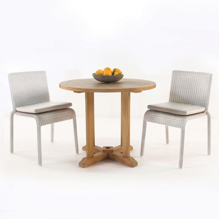 A cool and contemporary outdoor dining set pairing wicker chairs with an A-grade Teak Table.