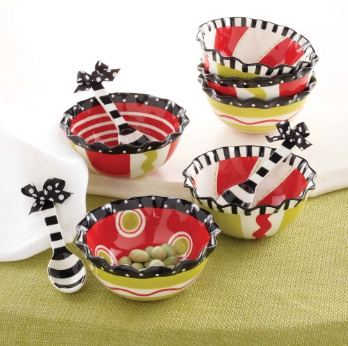 This 2 piece set comes complete with a hand painted ceramic dip bowl with ruffle rim and striped ceramic spoon. Each  style sold separate or collect all three and fill with holiday candy and treats for each room in the house! Part of Mud Pie's Christmas Ruffles collection.
