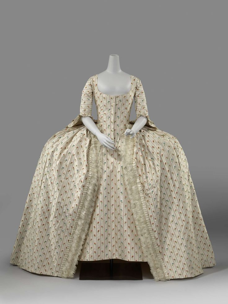 Robe à la francaise, The Netherlands, 1780. Cream silk embroidered with pink stripes and multi-coloured flowers with white cream colored bows.
