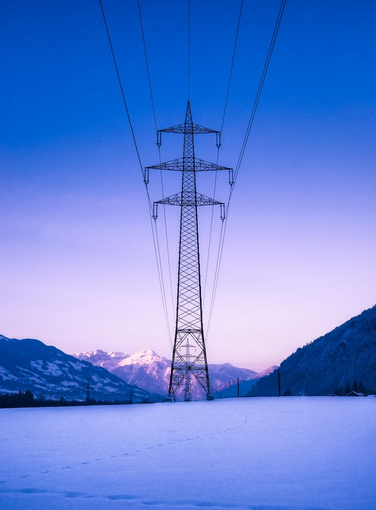 Powerlines inbetween the mountains - After a beautiful and exciting day of skiing and snowboarding, we decided to walk back to our hotel.  The trial went through the farm fields, over bridge and through the little town located inbetween big mountains.  Very impressing.