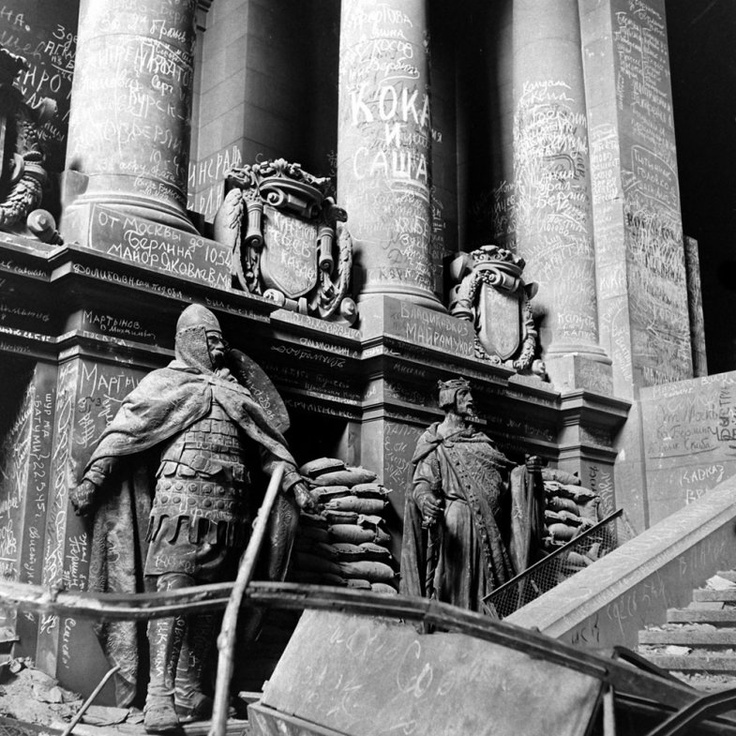 """Unpublished. A common practice of soldiers through the centuries: scrawling graffiti to honor fallen comrades, insult the vanquished, or simply announce, I was here. I survived. """"Columns at entrance into Chancellery gardens,"""" wrote Vandivert of this eerie scene, """"showing bomb and artillery wreckage and names of Russians who fell in fighting there."""""""