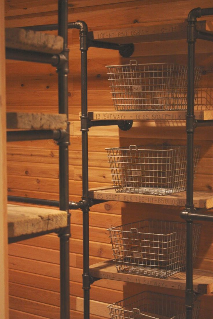 Good Industrial Pipe Closet System   Using Salvaged Boards For The Shelves And  Vintage Wire Locker Baskets