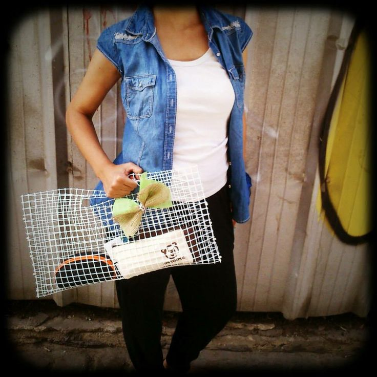 Upcycling. Bag made from plastic fence
