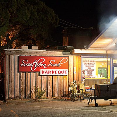 Southern Soul Barbeque, St. Simons Island, GA | Folks pack in for the salt- and sugar-cured ribs, smoked rotisserie-style and glazed with pan drippings, and righteous hoppin' John. | SouthernLiving.com
