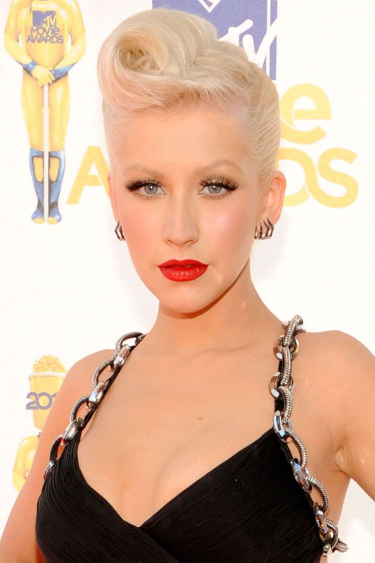 """Let's face it, [link url=""""http://www.glamourmagazine.co.uk/celebrity/biographies/christina-aguilera""""]Christina Aguilera[/link] does retro hair like no other with that shock of white-blonde hair. We love this ultra-stylish curled quiff and matching screen siren make-up – bravo, Xtina."""